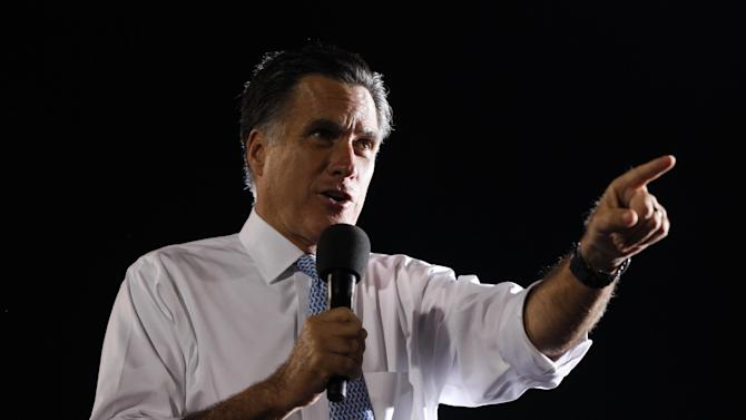 Republican presidential candidate and former Massachusetts Gov. Mitt Romney campaigns on the football field at Land O'Lakes High School in Land O'Lakes, Fla., Saturday, Oct. 27, 2012 after the motorcade was stopped. (AP Photo/Charles Dharapak)