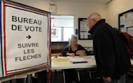 A French citizen has his name checked on the electoral roll before being allowed to cast his ballot at the French consulate in Sydney on May 6. French nationals in Australia began voting on Sunday in the second round of presidential elections in which President Nicolas Sarkozy is facing Socialist Francois Hollande