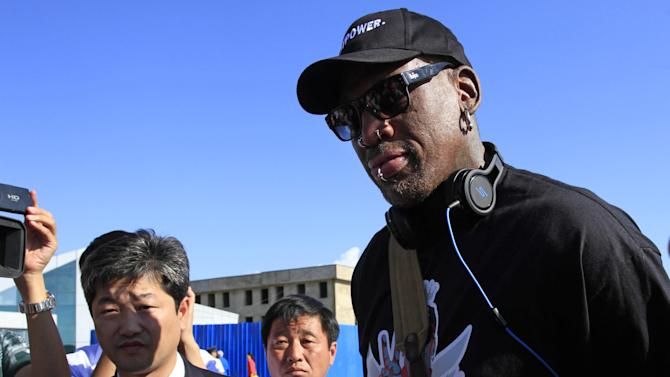 Former NBA star Dennis Rodman arrives at Pyongyang airport, North Korea, Tuesday, Sept. 3, 2013. Rodman landed Tuesday in North Korea and said he plans to hang out with authoritarian leader Kim Jong Un, have a good time and maybe bridge some cultural gaps — but not be a diplomat. (AP Photo/Jon Chol Jin)