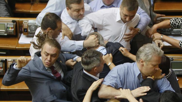 Ukrainian parliamentary deputies tussle during a session in parliament in Kiev
