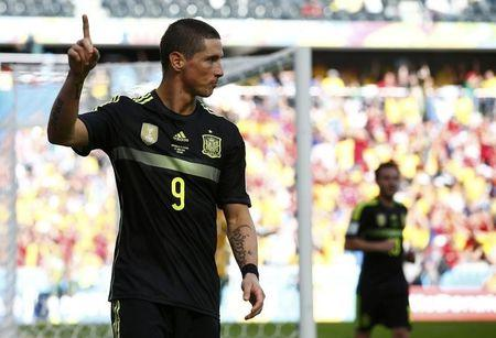Spain's Fernando Torres celebrates after scoring a goal during the 2014 World Cup Group B soccer match between Australia and Spain at the Baixada arena