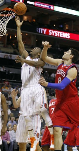 Holiday, Young lead 76ers past Bobcats 105-80