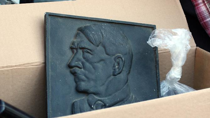 A representation of Adolf Hitler lies in a box after police searched the house of an alleged neo-Nazi in Juelich, western Germany, Thursday, Aug. 23, 2012. More than 900 police officers are searching homes and clubhouses of suspected neo-Nazis in a crackdown in the western state of North Rhine-Westphalia. Three organizations have been banned. The dapd news organization reported Thursday that some 120 buildings were searched in the raids. (AP Photo/dapd, Michael Klarmann)