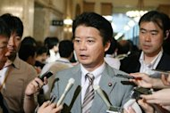 Japan&#39; s Foreign Minister Koichiro Gemba (C) speaks to reporters at parliament in Tokyo, on August 10. Gemba said on Saturday that Tokyo was considering asking the International Court of Justice to settle a bitter row with South Korea over a disputed island group, a day after S.Korean President Lee Myung-Bak made a surprise visit to the islands, known as Takeshima in Japanese and Dokdo in Korean