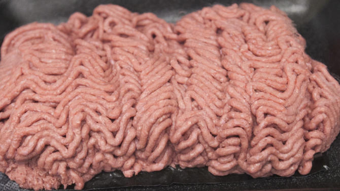 "FILE - In this March 29, 2012 file photo, the beef product known as lean finely textured beef, or ""pink slime,"" is displayed during a plant tour of Beef Products Inc. in South Sioux City, Neb., where the product is made. Gerald Zirnstein, the microbiologist who coined the term ""pink slime,"" says it came to him in the spur of the moment as he was composing an email to a coworker at the U.S. Department of Agriculture a decade ago. Although it's been used as a filler for decades, the product became the center of controversy only after Zirnstein's vivid moniker for it was quoted in a 2009 New York Times article on the safety of meat processing methods. (AP Photo/Nati Harnik, File)"