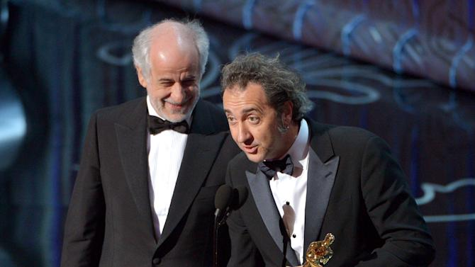 "Toni Servillo, left, and Paolo Sorrentino accept the award for best foreign language film of the year for ""The Great Beauty"" during the Oscars at the Dolby Theatre on Sunday, March 2, 2014, in Los Angeles. (Photo by John Shearer/Invision/AP)"