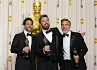 "Best picture winner ""Argo"" producers George Clooney (R), Grant Heslov and Ben Afleck (C) pose with their awards at the 85th Academy Awards in Hollywood, California February 24, 2013 REUTERS/ Mike Blake"