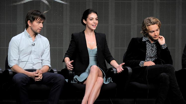 "Cast members, from left, Torrance Coombs, Adelaide Kane and Toby Regbo participate in the ""Reign"" panel at the CW Summer TCA on Tuesday, July 30, 2013, at the Beverly Hilton hotel in Beverly Hills, Calif. (Photo by Chris Pizzello/Invision/AP)"