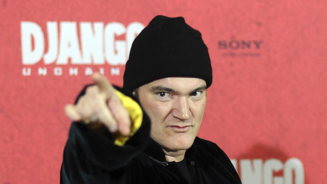 """US movie director Quentin Tarantino poses during a photo call ahead of tonight's premiere of his movie """"Django Unchained"""" in Berlin, Germany, Tuesday, Jan. 8, 2013. (AP photo/dpa, Britta Pedersen)"""