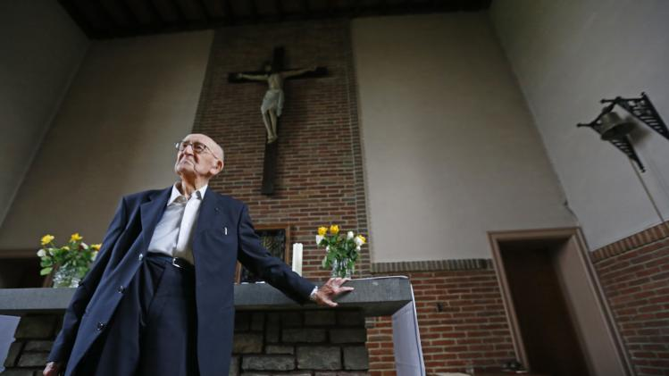 Father Jacques Clemens, 105, stands at St. Benoit church in Nalinnes