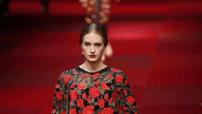 A model wears a creation for Dolce&Gabbana women's spring-summer 2015 collection, part of the Milan Fashion Week, unveiled in Milan, Italy, Sunday, Sept. 21, 2014. (AP Photo/Luca Bruno)