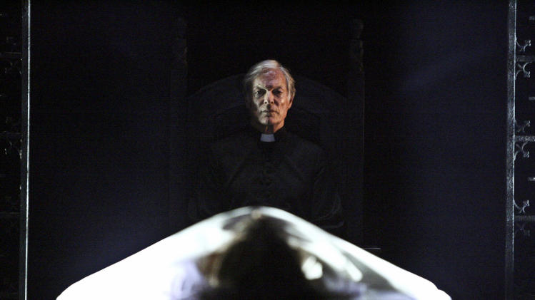 """This undated theater image released by the Geffen Playhouse shows Richard Chamberlain in the world premiere of John Pielmeier's """"The Exorcist"""" at the Geffen Playhouse in Los Angeles. The play, an adaptation of the 1971 William Peter Blatty novel, runs through Aug. 12. (AP Photo/Geffen Playhouse, Michael Lamont)"""