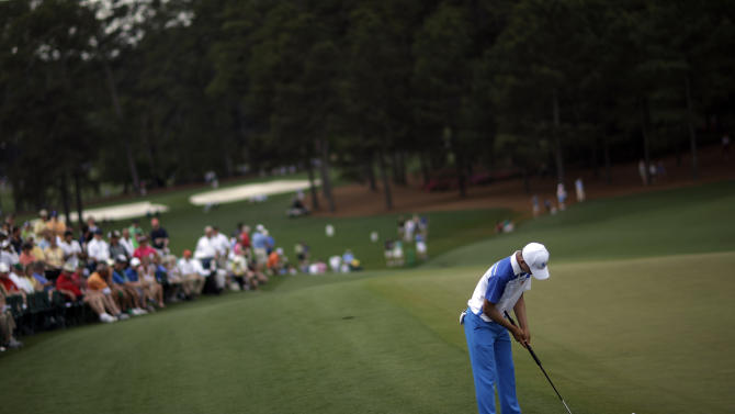 Amateur Guan Tianlang, of China, putts on the ninth green during the first round of the Masters golf tournament Thursday, April 11, 2013, in Augusta, Ga. (AP Photo/David Goldman)