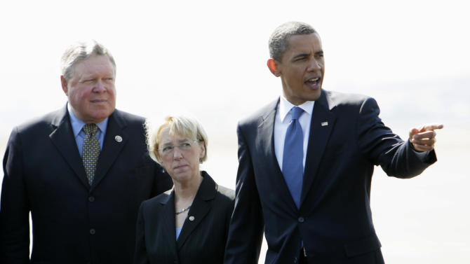 FILE - In this Aug. 17, 2010 file photo, President Barack Obama, stands with Rep. Norm Dicks, D-Wash., left, and Sen. Patty Murray, D-Wash., on the tarmac at the Seattle King County International Airport in Seattle. Washington Democratic Rep. Norm Dicks, the top Democrat on the powerful House Appropriations Committee, says he'll retire at the end of the year after 18 terms in the House. (AP Photo/Carolyn Kaster, File)