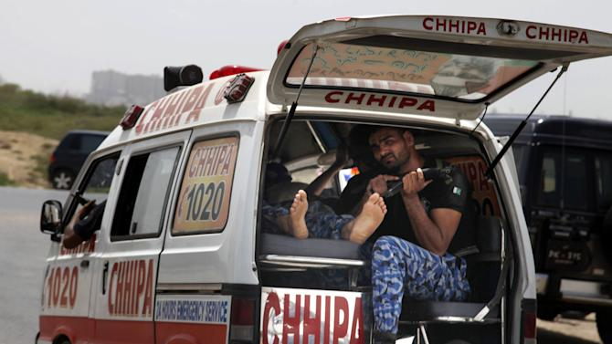 An ambulance rushes to a hospital after gunmen attacked a training center for airport security personnel in Karachi, Pakistan, Tuesday, June 10, 2014. Gunmen in Pakistan attacked a training facility near the Karachi airport on Tuesday, a spokesman said. The facility is roughly one kilometer (half mile) from the Karachi international airport. (AP Photo/Shakil Adil)
