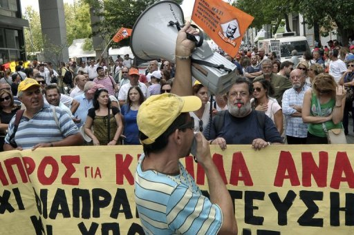 <p>Municipality workers protest at the finance ministry in Athens on September 12. Greece's international creditors no longer believe Athens can achieve its financial objectives, especially a reduction in its debt burden, the German business newspaper Handelsblatt reported.</p>