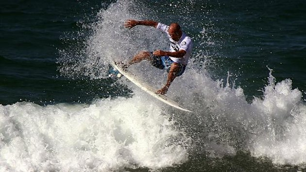 Eleven-time world surfing champion Kelly Slater of the USA rides a wave (Reuters)