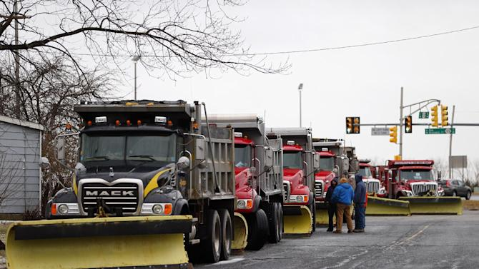 Private contractors working for the N.J. Dept. of Transportation wait for the snow to start falling as 13 trucks are lined up just off exit 3 on Rt. 78 in Greenwich, N.J., Friday, Feb. 8, 2013. Snow began falling across the Northeast on Friday, ushering in what was predicted to be a huge, possibly historic blizzard and sending residents scurrying to stock up on food and gas up their cars. The storm could dump 1 to 3 feet of snow from New York City to Boston and beyond. (AP Photo/Rich Schultz)