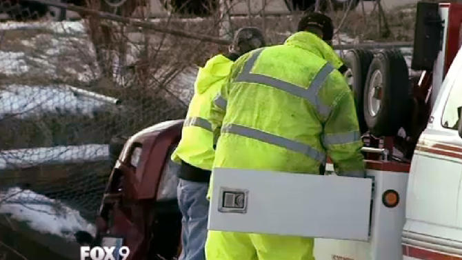 This Jan. 13, 2013 frame grab provided by KMSP-TV shows police officials recovering a car from a pond in Plymouth, Minn. Authorities say Nancy Breberg, of Centerville, veered off the road Saturday, crashed through a fence, landed on the pond and became trapped in her overturned car for 18 hours until a bicyclist found her Sunday. Breberg's husband said Monday she is expected to recover. (AP Photo/Courtesy KMSP-TV)