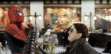 Spider-Man ( Tobey Maguire ) in the clutches of Doc Ock ( Alfred Molina ) in Columbia Pictures' Spider-Man 2