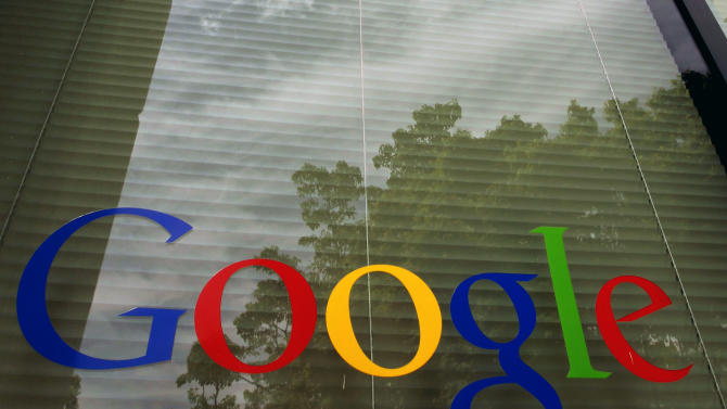 FILE- This April 12, 2012, photo shows a Google logo on a window at the company's headquarters in Mountain View, Calif. Google's latest quarterly results reported Thursday, April 18, 2013 provided further proof that the Internet search leader is figuring out how to make more money as Web surfers migrate from personal computers to mobile devices.  (AP Photo/Paul Sakuma, File)