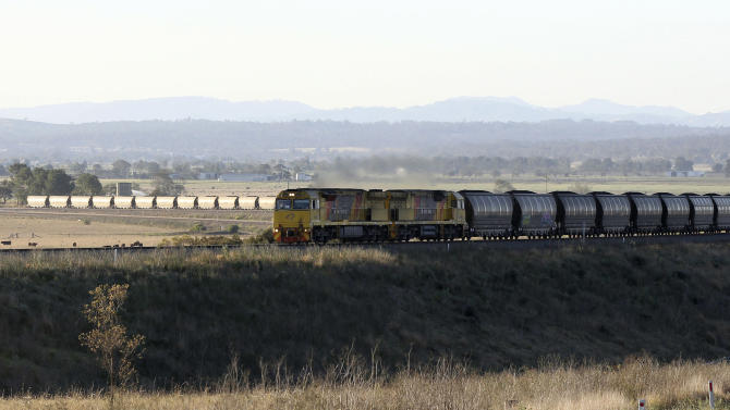 In this Sept. 11, 2012 photo, a coal train leaves Gunnedah, Australia, 450 kilometers (280 miles) northwest of Sydney. At present, a coal train leaves or arrives in the region once every two-to-three hours, but is expected to increase to one every 19 minutes once proposed mines are in full swing. (AP Photo/Rob Griffith)
