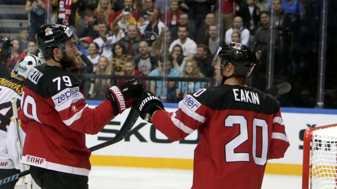 Canada's Eakin celebrates with his teammate O'Reilly after scoring a goal against Germany during their Ice Hockey World Championship game at the O2 arena in Prague