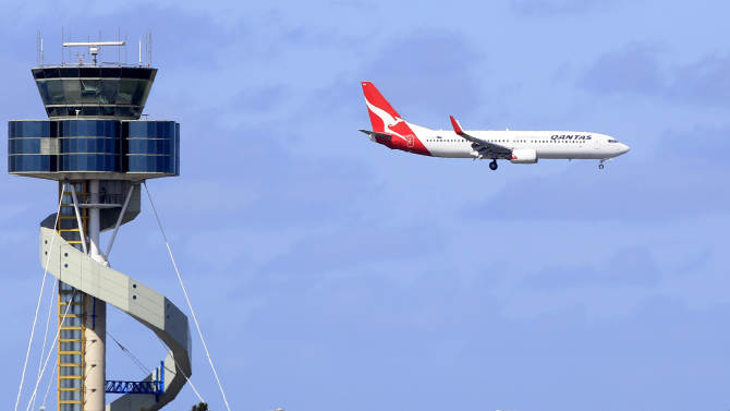 A Qantas jet prepares to land at Sydney Airport in Sydney, Monday, Oct. 31, 2011. Qantas Airways planes returned to the skies after an Australian court ruled on a bitter labor dispute that had prompted the world's 10th-largest airline to ground its entire fleet. (AP Photo/Rick Rycroft)