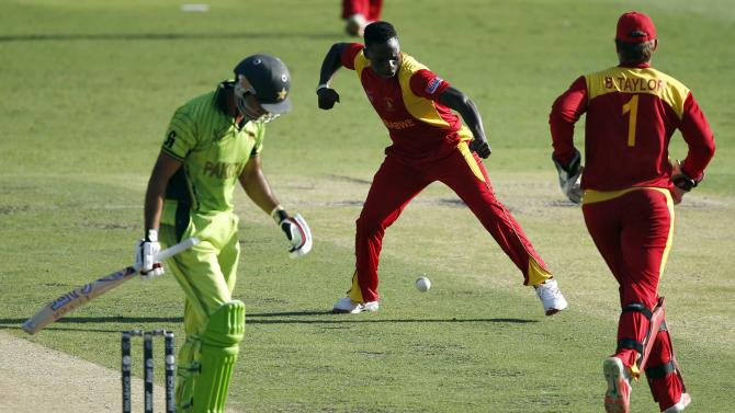 Zimbabwe's Tawanda Mupariwa celebrates after dismissing Pakistan's Sohaib Maqsood for 21 runs during their Cricket World Cup match at the Gabba in Brisbane