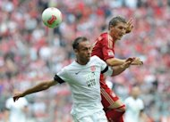 Bayern Munich's midfielder Bastian Schweinsteiger (R) and Mainz's defender Nikolce Noveski (L) fight for the ball during their German first division Bundesliga football match in Munich, southern Germany. Bayern Munich won the match 3-1
