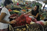 A customer buys chillies at a market in Jakarta. Indonesia said on July 2 inflation rose to 4.53 percent in June, spurred by higher basic food prices including red chillies, a main ingredient in local dishes. AFP PHOTO / ROMEO GACAD