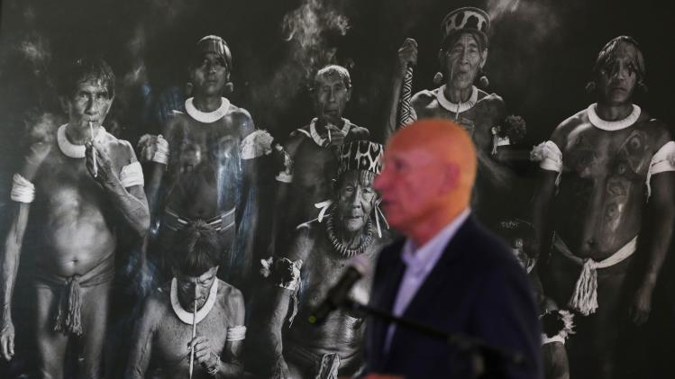 "Brazilian photographer Sebastiao Salgado speaks in front one of pictures during donation ceremony of photograph ""Xamas no Xingu"" to Brazilian government, at the Itamaraty Palace in Brasilia"