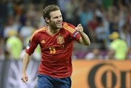 Chelsea midfielder Juan Mata, seen here on July 1, is hoping to complete a remarkable clean sweep of silverware having been a member of Spain&#39;s Euro 2012-winning squad after earlier lifting the Champions League in May with his club