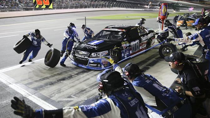 Dale Earnhardt Jr. pits for fuel and tires during a NASCAR Sprint Cup series auto race at Daytona International Speedway, Monday, July 6, 2015, in Daytona Beach, Fla. (AP Photo/Alex Menendez)