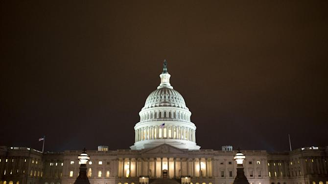 The lights of the U.S. Capitol remain lit into the night on Tuesday, Jan. 1, 2013. In the short term, the economy's headwinds are still restraining growth, including, th heaviest millstone weighing down the economy; the rift between President Barack Obama and Republicans over taxes and spending. (AP Photo/Jacquelyn Martin)