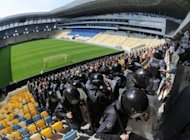 Riot policemen during a drill at Ukraine's Lviv Arena stadium on May 4. An outraged Ukraine on Tuesday hit back at the British media, current and former footballers for urging fans to stay away from next month's Euro 2012 tournament over fears of racism and violence in the ex-Soviet state