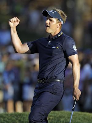 Luke Donald, of England, pumps his fist after winning the Transitions Championship golf tournament in a playoff Sunday, March 18, 2012, in Palm Harbor, Fla. (AP Photo/Chris O'Meara)