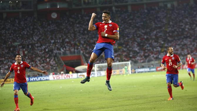 Chile's  Alexis Sanchez  celebrates goal against Peru during 2018 World Cup qualifying soccer match at Nacional stadium in Lima
