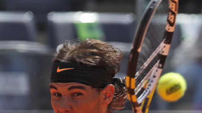 Spain's Rafael Nadal returns the ball to Tomas Berdych of Czech Republic during their quarter final match at the Italian Open tennis tournament, in Rome, Friday,  May 18, 2012. (AP Photo/Alessandra Tarantino)