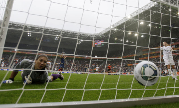 United States goalkeeper Hope Solo looks at the ball in the net after France scored their first goal during the semifinal match between France and the United States at the Women's Soccer World Cup in