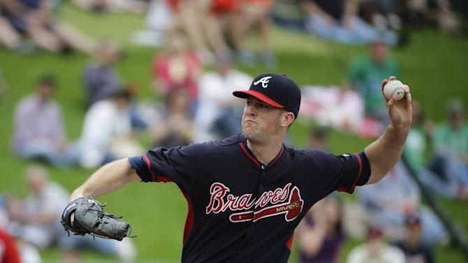 FILE - In this March 6, 2015, file photo, Atlanta Braves starting pitcher Alex Wood throws in the first inning of an exhibition spring training baseball game against the Washington Nationals in Kissimmee, Fla. Wood, known for his quirky delivery, said he has always established high expectations for himself, going back to his days as a high-school standout in Charlotte, North Carolina and then, collegiately at Georgia. (AP Photo/David Goldman, File)