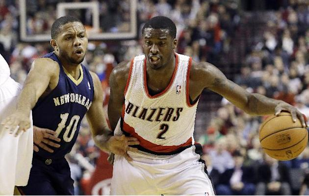 Portland Trail Blazers guard Wesley Matthews, right, drives past New Orleans Pelicans guard Eric Gordon during the first half of an NBA basketball game in Portland, Ore., Saturday, Dec. 21, 2013