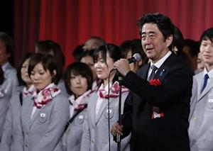 Japan's PM Abe attends a send-off ceremony for the Japanese team's departure to the Sochi 2014 Winter Olympic Games, in Tokyo