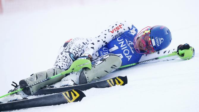 Velez Zuzulova from Slovakia lies on the snow after missing a gate during the first run of the World Cup Women's Slalom race in Kuehtai ski resort