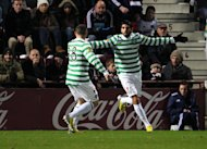 Lassad Nouioui, right, set Celtic on their way to victory at Hearts