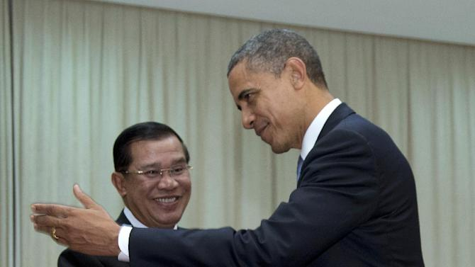United States President Barack Obama is welcomed by Cambodia's Prime Minister Hun Sen as he arrives at the  Peace Palace in Phnom Penh, Cambodia, Monday, Nov. 19, 2012, Obama will attend the East Asia Summit.  (AP Photo/Carolyn Kaster)