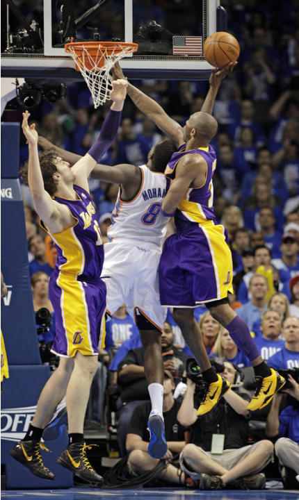 Kobe Bryant #24 Of The Los Angeles Lakers Shoots Getty Images