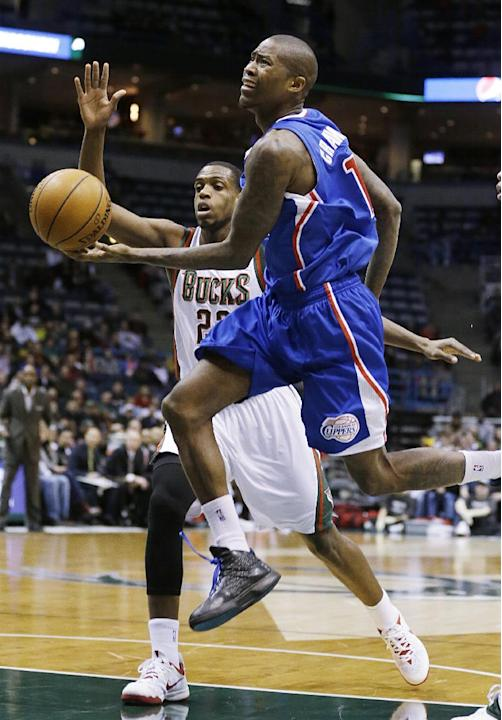 Los Angeles Clippers' Jamal Crawford, right, drives to the basket against Milwaukee Bucks' Khris Middleton (22) during the first half of an NBA basketball game, Monday, Jan. 27, 2014, in Milwa