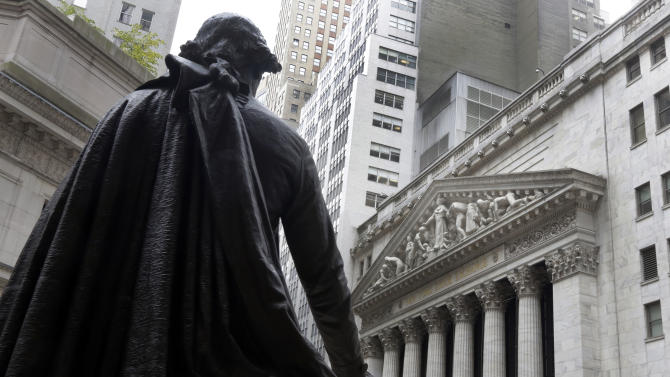 FILE - In this Oct. 2, 2014, file photo, the statue of George Washington on the steps of Federal Hall faces the facade of the New York Stock Exchange. Global financial markets shrugged off the election victory of an anti-austerity party in Greece, with most investors appearing to conclude on Monday, Jan. 26, 2015, that it is unlikely to lead the country to fall out of the euro. (AP Photo/Richard Drew, File)