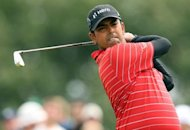 Anirban Lahiri of India watches his shot from the 4th tee during his third round of the 2012 British Open Golf Championship at Royal Lytham and St Annes in England. Lahiri aced the par-3 ninth hole at Royal Lytham on Saturday in the third round of the British Open, stunning himself in his major championship debut with the shot of his life
